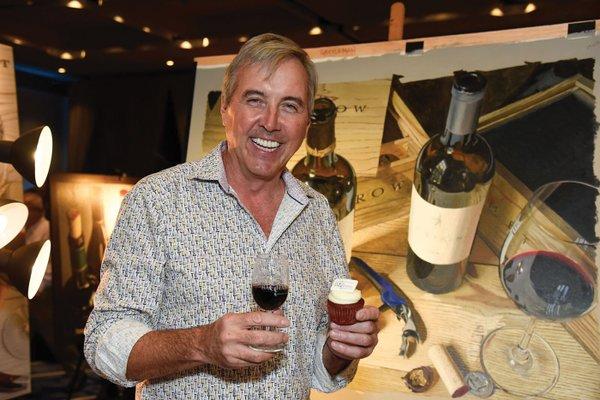 Thomas Arvid with Boca Bacchanal branded wine glass and cupcake.jpg