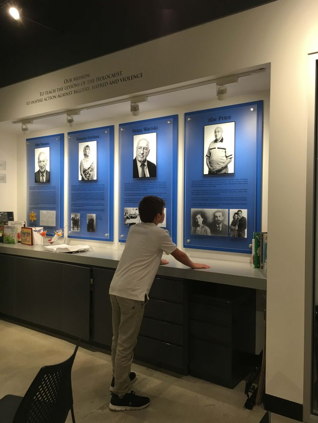 New Museum - Student - boy looking at Survivor stories_web.jpg
