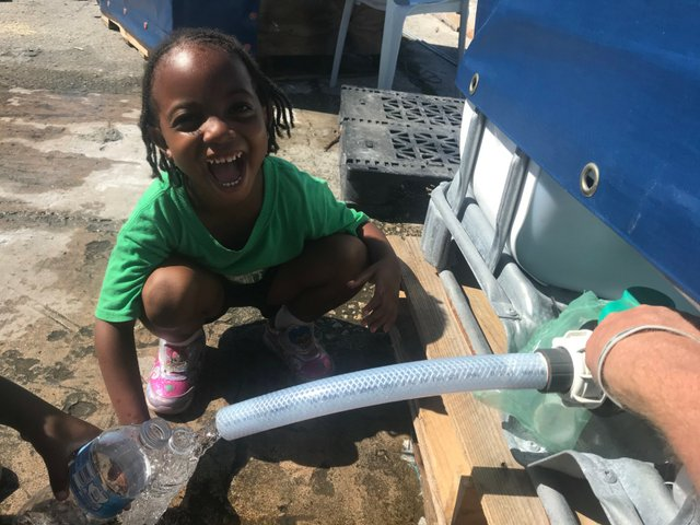 Little girl elated to be getting clean water - Copy.jpg